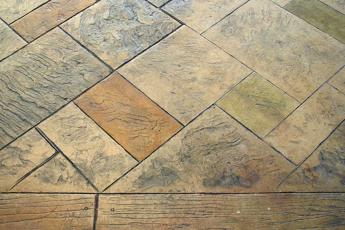 Stamped concrete patterns, mixed with acid stain coloring