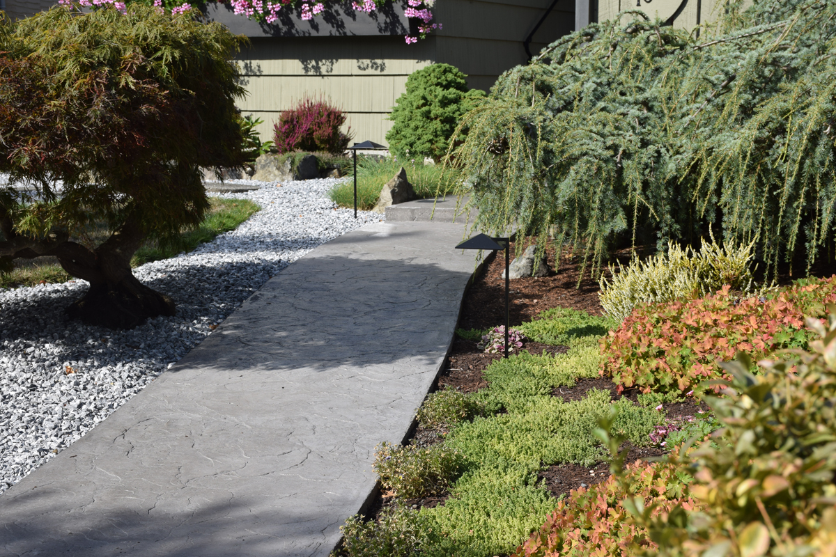 Stamped concrete in a curving outdoor pathway